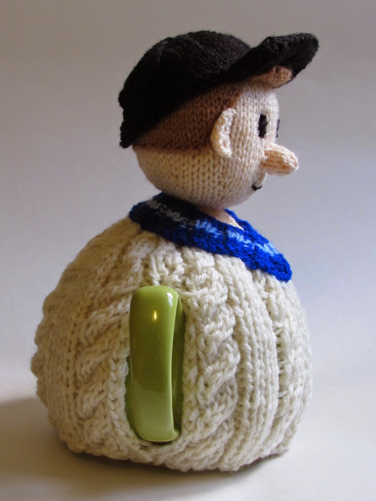 Cricketer tea cosy side view