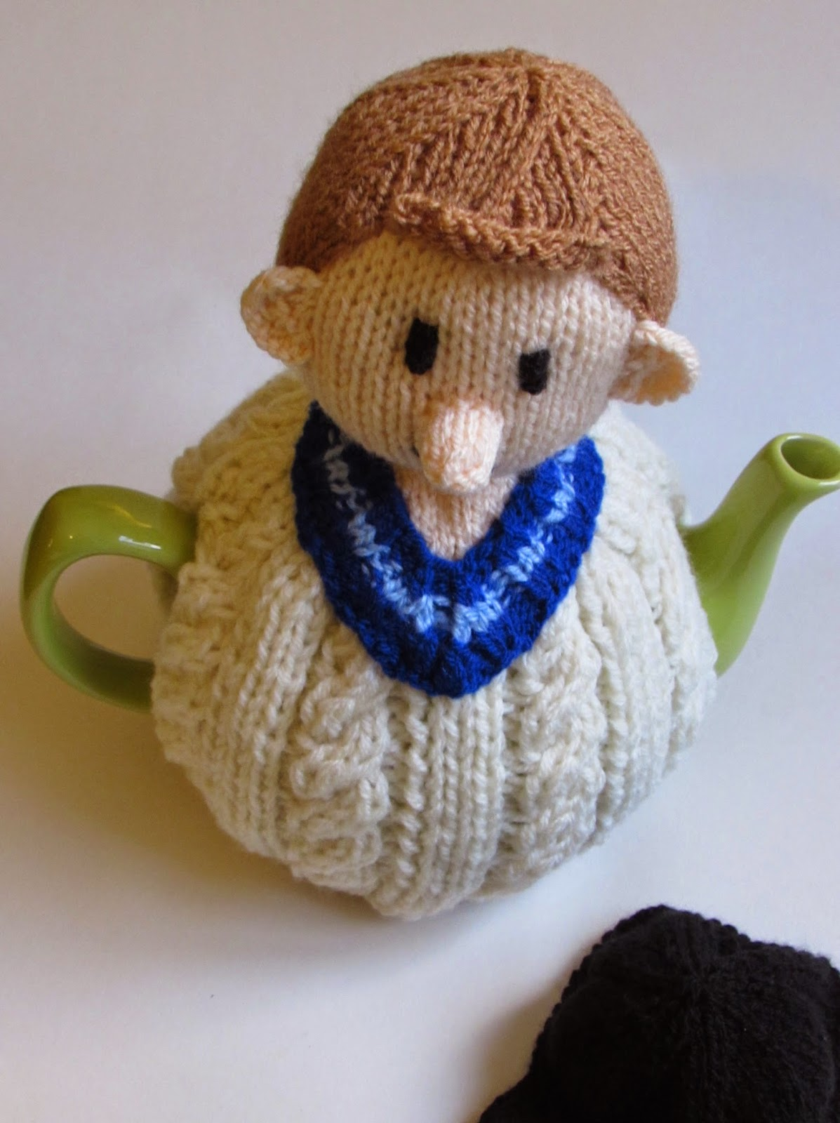 Cricketer tea cosy top view